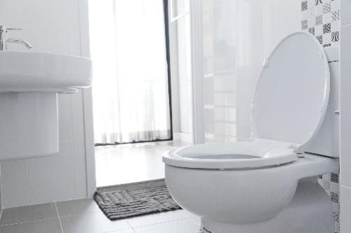 As a man, when sitting on the toilet I have difficulty directing my urine into the bowl